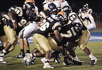 Florida International University Golden Panthers v. Bowling Green University Falcons at Miami, Florida on Saturday, September 16, 2006...Senior linebacker Keyonvis Bouie (7).Senior defensive back Chris Smith (26).Junior defensive lineman Roland Clarke (99).Sophomore defensive lineman Jonathan Betancourt (94)