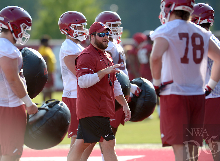 NWA Democrat-Gazette/ANDY SHUPE<br /> Arkansas offensive line coach Dustin Fry speaks to his players Friday, Aug. 3, 2018, during practice at the university practice field on campus in Fayetteville. Visit nwadg.com/photos to see more photographs from the practice.