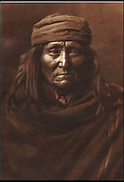 BNPS.co.uk (01202 558833)<br /> Pic: Bloomsbury/BNPS<br /> <br /> Eskadi of the Apache tribe in 1903.<br /> <br /> Lost souls - Poignant archive reveals the lost tribes of North America in beautiful photographs from just over a century ago.<br /> <br /> A remarkable collection of photographs which give an unprecedented insight into the lives of Native Americans at a time when their land was being taken from them have emerged at auction.<br /> <br /> Between 1907 and 1930, US photographer Edward Curtis spent time with more than 80 native tribes across Native America, taking thousands of photographs as part of his groundbreaking The North American Indian project.<br /> <br /> A collection of more than 500 rare Curtis photographs are being auctioned off later this month and are expected to fetch over &pound;300,000.