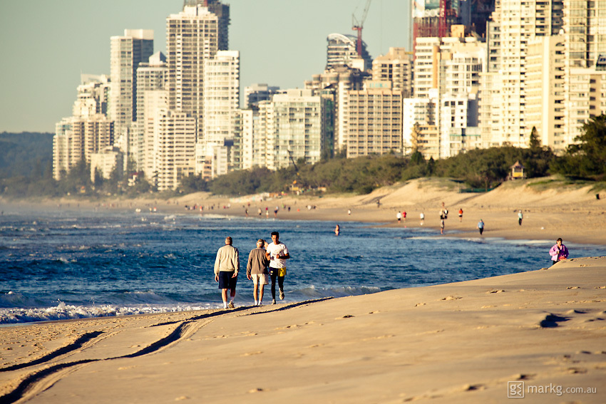 Early morning walkers looking south towards Surfers Paradise - Gold Coast, Australia