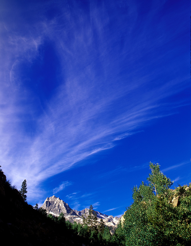 """Streaking clouds of approaching storm above """"Inconsolable Range"""" near North Lake, Eastern Sierras. California"""