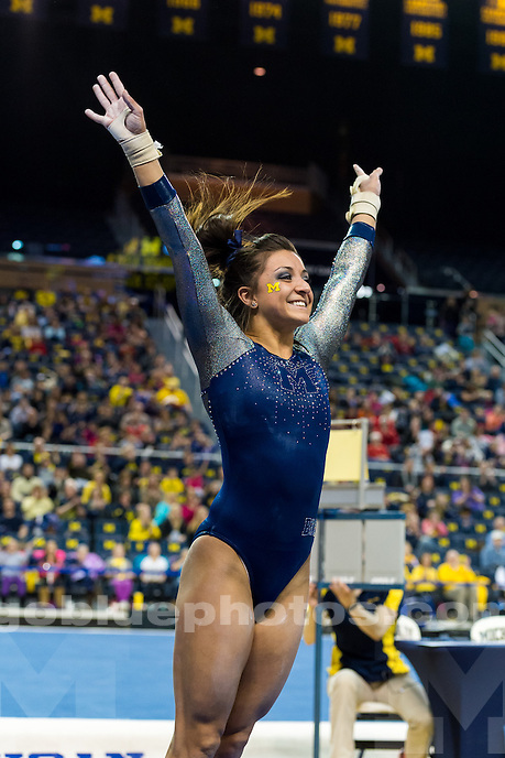 The University of Michigan women's gymnastics team defeats N.Carolina State, 197.250-194.800,on senior night at the Crisler Center in Ann Arbor, Mich. on Febuary 28, 2015.