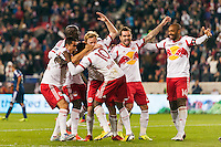 Lloyd Sam (10) of the New York Red Bulls celebrates scoring with teammates. The New York Red Bulls defeated the Chicago Fire 5-2 during a Major League Soccer (MLS) match at Red Bull Arena in Harrison, NJ, on October 27, 2013.