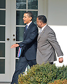 Washington, D.C. - March 6, 2009 -- United States President Barack Obama, left, walks on the Colonnade of the White House in Washington, D.C. with White House Chief Usher Stephen W. Rochon, right, on Friday, March 6, 2009 en route to the Oval Office. He is scheduled to make remarks at the Columbus (Ohio) Police Graduation Exercise later in the morning..Credit: Ron Sachs / Pool via CNP