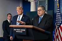 United States President Donald J. Trump, left, listens as United States Attorney General William P. Barr, right, speaks during a news briefing by members of the Coronavirus Task Force at the White House in Washington, DC on Monday, March 23, 2020.<br /> Credit: Chris Kleponis / Pool via CNP/AdMedia