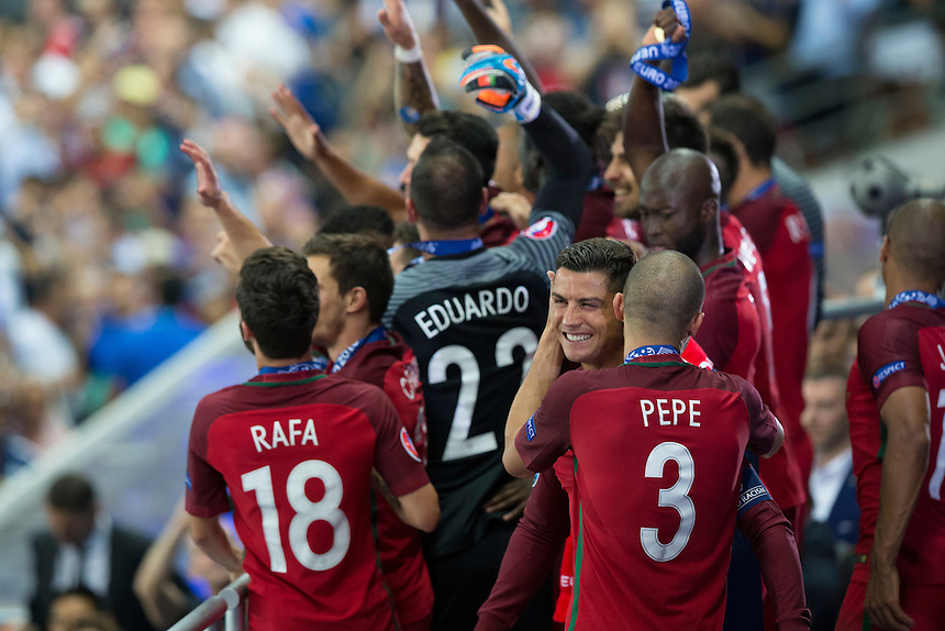 Portugal's Cristiano Ronaldo celebrates with team mate  Pepe as his side lift the winners trophy<br /> <br /> Photographer Craig Mercer/CameraSport<br /> <br /> International Football - 2016 UEFA European Championship - Final - Portugal v France - Sunday 10th July 2016 - Stade de France - Saint-Denis - Paris - France<br /> <br /> World Copyright &copy; 2016 CameraSport. All rights reserved. 43 Linden Ave. Countesthorpe. Leicester. England. LE8 5PG - Tel: +44 (0) 116 277 4147 - admin@camerasport.com - www.camerasport.com