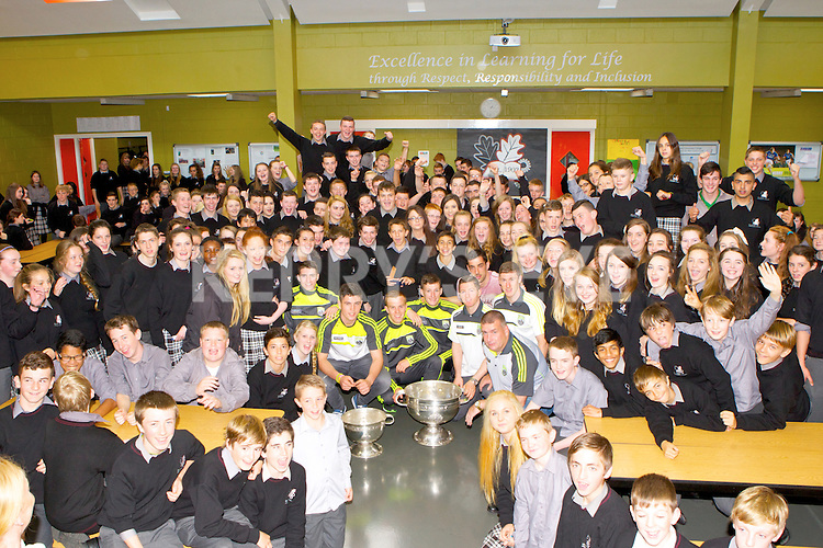 County Board Chairman Patrick O'Sullivan and Kerry footballers Jordan Kiely, Liam Kearney, Fionn Fitzgerald, Brian Kelly, Jonathan Lyne and Anthony Maher brought the Sam McGuire and Tom Markam cups to Killarney Community College on Tuesday