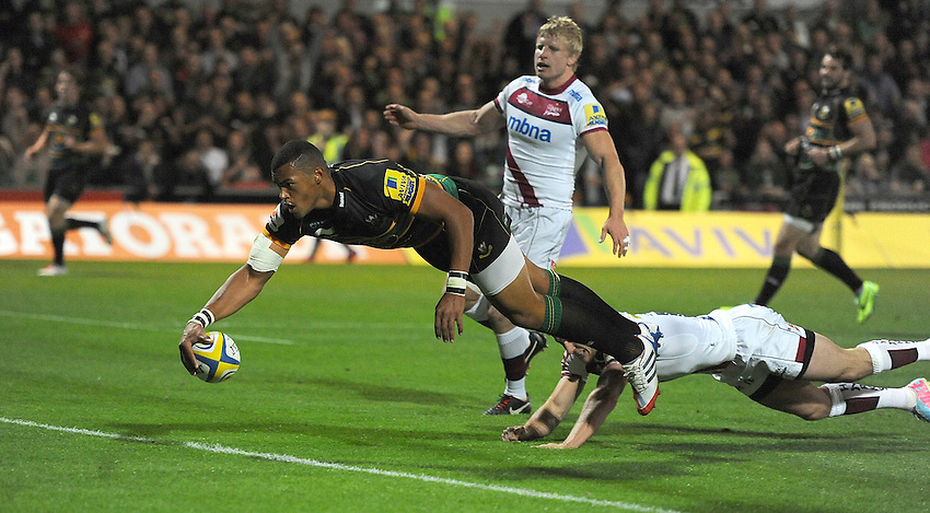 Northampton Saints' Luther Burrell dives over the try line to score the opening try<br /> <br /> Photo by Stephen White/CameraSport<br /> <br /> Rugby Union - Aviva Premiership - Northampton Saints v Sale Sharks - Friday 27th September 2013 - Franklin's Gardens - Northampton<br /> <br /> &copy; CameraSport - 43 Linden Ave. Countesthorpe. Leicester. England. LE8 5PG - Tel: +44 (0) 116 277 4147 - admin@camerasport.com - www.camerasport.com