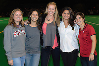 STANFORD, CA - OCTOBER 21, 2011: Stanford field hockey alumnae get together during half-time at a game between Stanford field hockey and UC Davis at the Varsity Field Hockey Turf in Stanford, California on October 21, 2011.  Stanford defeated UC Davis, 5-0.