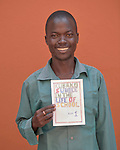 A student at the Solidarity Teacher Training College (STTC) in Yambio, South Sudan, holds a story he created. The STTC is run by Solidarity with South Sudan, an international network of Catholic groups working to train teachers, health workers and pastoral agents throughout the African country.