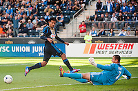 Houston Dynamo goalkeeper Tally Hall (1) makes a save on Josue Martinez (17) of the Philadelphia Union. during a Major League Soccer (MLS) match at PPL Park in Chester, PA, on September 23, 2012.