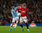 Riyad Marhez of Manchester City tackles Brandon Williams of Manchester United during the Carabao Cup match at Old Trafford, Manchester. Picture date: 7th January 2020. Picture credit should read: Darren Staples/Sportimage