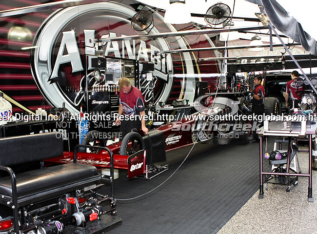 Al-Anabi Racing's Top Fuel Dragster's crew getting the top fuel dragster ready to do battle at the O'Reilly Fall Nationals held at the Texas Motorplex in  Ennis, Texas.