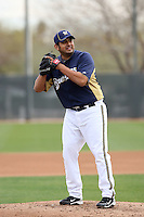 Zack Segovia #71 of the Milwaukee Brewers participates in pitchers fielding practice during spring training workouts at the Brewers complex on February 18, 2011  in Phoenix, Arizona. .Photo by Bill Mitchell / Four Seam Images.