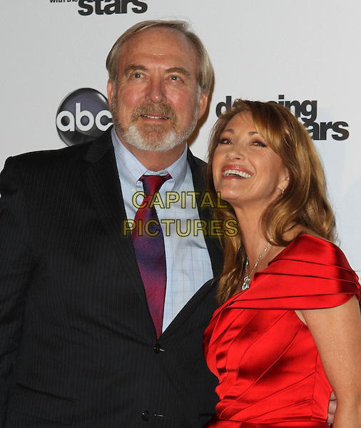 JAMES KEACH & JANE SEYMOUR.'Dancing With The Stars' 200th Episode held at Boulevard 3, Hollywood, CA, USA..November 1st, 2010.half length black suit red silk satin dress smiling married husband wife.CAP/ADM/FS.©Faye Sadou/AdMedia/Capital Pictures.
