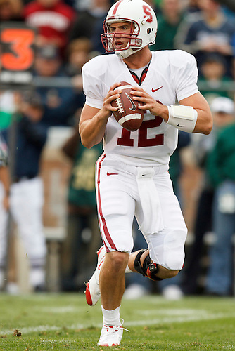 Stanford quarterback Andrew Luck (#12) drops back to pass during NCAA football game between Stanford and Notre Dame.  The Stanford Cardinal defeated the Notre Dame Fighting Irish 37-14 in game at Notre Dame Stadium in South Bend, Indiana.