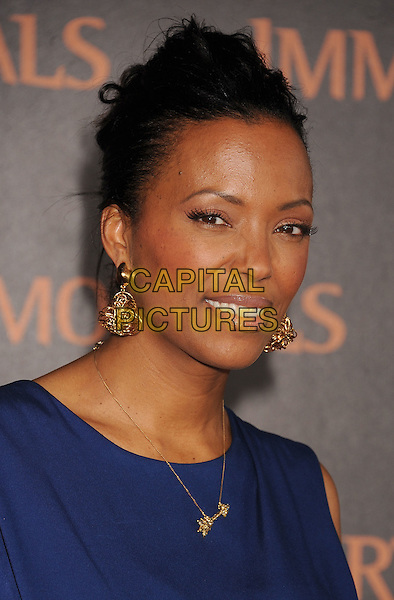 "Aisha Tyler .World Premiere of ""Immortals 3D"" at Nokia Theatre L.A. Live in Los Angeles, California, USA..November 7th, 2011.headshot portrait blue gold earrings necklace .CAP/ROT/TM.© TM/Roth/Capital Pictures"