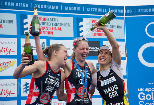 14 SEP 2013 - LONDON, GBR - Non Stanford (GBR) (centre) of Great Britain celebrates winning the elite women's ITU World Triathlon Series, after her victory at the elite women's ITU 2013 World Triathlon Series Grand Final in Hyde Park, London, Great Britain, with  overall runner up Jodie Stimpson (GBR) (left) of Great Britain and third place overall  Anne Haug (GER) (right) of Germany (PHOTO COPYRIGHT © 2013 NIGEL FARROW, ALL RIGHTS RESERVED)