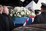 © Joel Goodman - 07973 332324 . No syndication permitted . 11/11/2012 . Lytham Park Crematorium , UK . The coffin is unloaded from the hearse . Hundreds of strangers at the funeral of World War Two veteran Harold Jellicoe Percival today (Monday 11th November 2013) . The funeral is timed to coincide with the First World War armistice , the 95th anniversary of which is at 11am today (Monday 11th November 2013) . The RAF Bomber Command veteran died in his sleep on 25th October 2013 , aged 99 , at Alistre Lodge Nursing Home in St Annes , Lancashire , with no immediate family . Photo credit : Joel Goodman