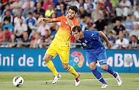 GETAFE, ESPANHA, 15 SETEMBRO 2012 - CAMP. ESPANHOL - GETAFE X BARCELONA - Fabregas (E) jogador do Barcelona durante lance de partida contra o Getafe em jogo valido pela 4 rodada do campeonato espanhol em Getafe na Espanha, neste sabado. O Barcelona venceu por 4 a 1 e se mantem na lideranca. (FOTO: ALFAQUI / BRAZIL PHOTO PRESS).