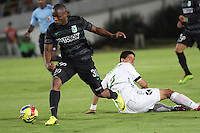 BOGOTA -COLOMBIA, 1 -SEPTIEMBRE-2014. Daniel Briceño ( D) de La Equidad  F.C. disputa el balón con  Miller Mosquera  del Atletico Nacional  durante partido de la  septima  fecha  de La Liga Postobón 2014-2. Estadio Nemesio Camacho El Campin . / Daniel Briceño (R) of Equidad FC    fights for the ball with Miller Mosquera of Atletico Nacional    during match of the 7th date of Postobon  League 2014-2. El Campin  Stadium. Photo: VizzorImage / Felipe Caicedo / Staff