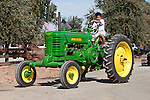 Annual fall Gas-Up at McFarland Ranch near Galt, Calif. of Branch 13, Early-Day Gas Engine and Tractor Association. (EDGE & TA)..vintage John Deere Tractor driven by a young man