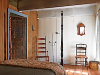 A small rear bedroom overlooks the courtyard, its door and beamed ceiling showing the patina of age and wear