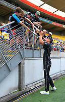 Trent Boult signs sutographs for fans during the One Day International between the New Zealand Black Caps and England at the Westpac Stadium in Wellington, New Zealand on Friday, 2 March 2018. Photo: Dave Lintott / lintottphoto.co.nz