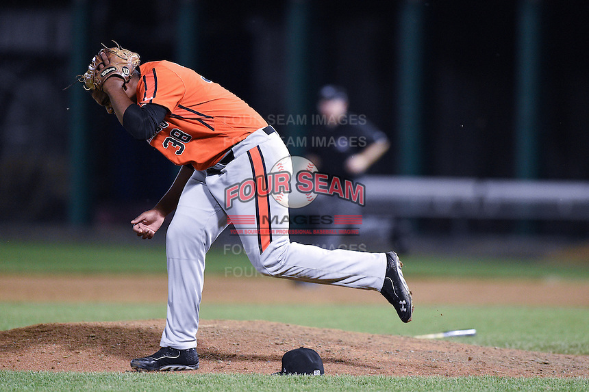 Aberdeen IronBirds pitcher Ivan Hernandez (38) grabs his head after getting hit by a broken bat during a game against the Williamsport Crosscutters on August 4, 2014 at Bowman Field in Williamsport, Pennsylvania.  Aberdeen defeated Williamsport 6-3.  (Mike Janes/Four Seam Images)