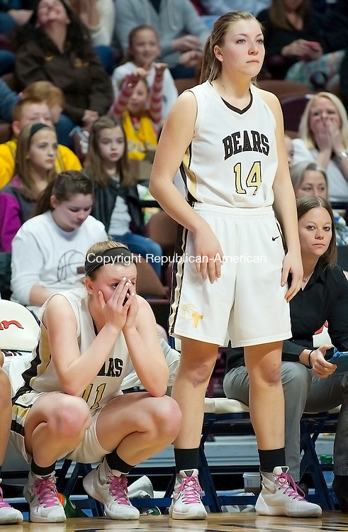 UNCASVILLE, CT--- -031916JS18- Thomaston's Gabrielle Hurlbert and Morgan Sanson look on as time winds down in their loss to Canton in the Class S state championship game Saturday at Mohegan Sun Arena. <br /> Jim Shannon Republican-American