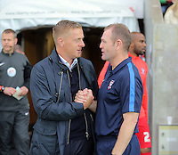Pictured L-R: Swansea manager Garry Monk greets York City manager Russ Wilcox Tuesday 25 August 2015<br /> Re: Capital One Cup, Round Two, Swansea City v York City at the Liberty Stadium, Swansea, UK.