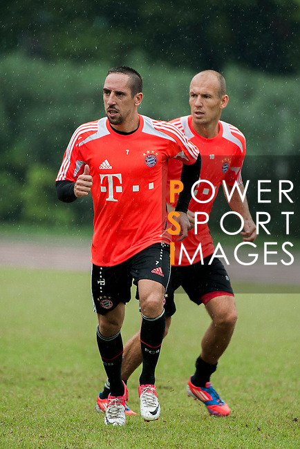 Arjen Robben and Franck Ribery of Bayern Munich in action during a training session ahead the friendly match against VfL Wolfsburg as part of the Audi Football Summit 2012 on July 26, 2012 at the Tianhe Sports Stadium in Guangzhou, China. Photo by Victor Fraile / The Power of Sport Images