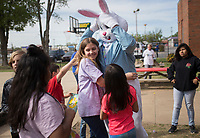 NWA Democrat-Gazette/CHARLIE KAIJO Rose Nemec 11 (center) hugs Attorney Kyle Heffley, dressed as the Easter bunny, during an Easter egg hunt, Friday, April 12, 2019 at the Boys and Girls Club in Rogers. <br /> <br /> The Mitchell Williams Law Firm gave the Boys and Girls club of Rogers a $15,000 grant and held an egg hunt for the kids of the club. They offer grants each year through a program called Take Time To Give. The purpose is to encourage the law staff to do charitable work said Kyle Heffley, an attorney from the firm. <br /> <br /> The Boys and Girls club has five facilities in the county serving 150-200 kids at each site. The clubs experience a lot of wear-and-tear. Contributions from community organizations help the staff to focus on serving the kids.