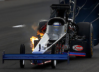 Sep 28, 2013; Madison, IL, USA; NHRA top fuel dragster driver Pat Dakin has a small fire during qualifying for the Midwest Nationals at Gateway Motorsports Park. Mandatory Credit: Mark J. Rebilas-
