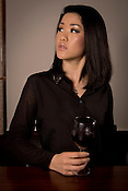 A young Japanese lady at a wine bar.