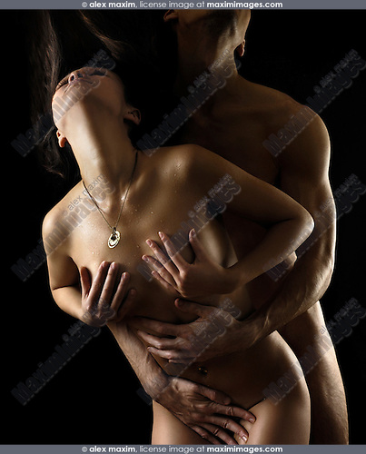 Young naked couple making love. Isolated silhouettes on black background.