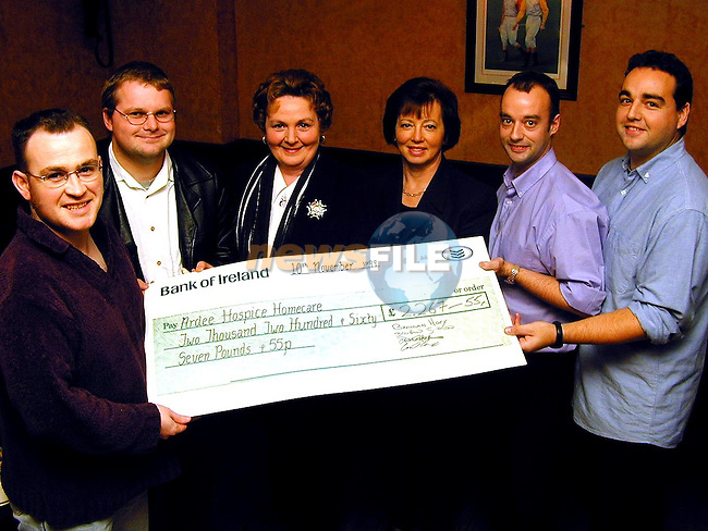 Brendan Gillispie, Conor Thorne, Brendan Hoey and David Hoey presenting a cheque to Alice Hennessy, chairperson Ardee Hospice Homecare and Mary Durrigan, treasurer Ardee Hospice Homecare..Picture Paul Mohan Newsfile