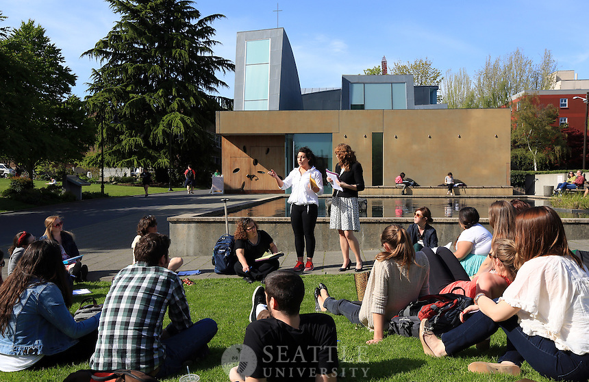 04242013- Students take part in a class hled outside in front of the Chapel on campus as warm Spring weather hits Seattle University.