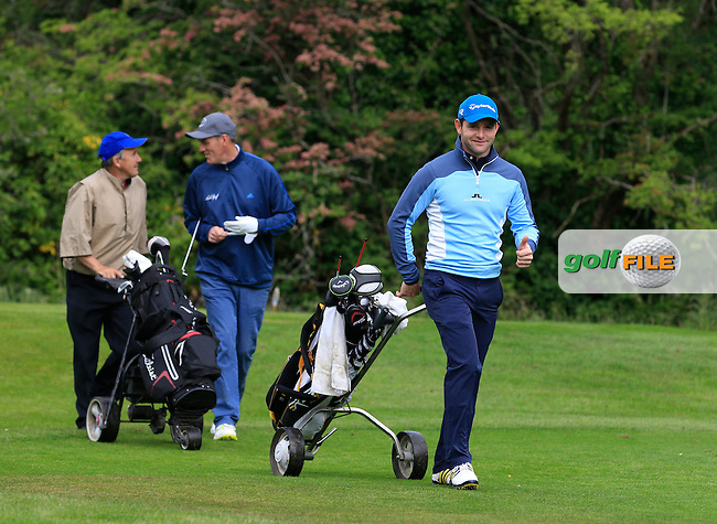 Peter Kirby (Dun Laoghaire) walks off the 2nd tee after hitting a superb ball onto the green during Round 3 of the Irish Mid-Amateur Open Championship at New Forest on Sunday 21st June 2015.<br /> Picture:  Thos Caffrey / www.golffile.ie