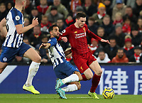 30th November 2019; Anfield, Liverpool, Merseyside, England; English Premier League Football, Liverpool versus Brighton and Hove Albion; Martín Montoya of Brighton tackles Andy Robertson of Liverpool - Strictly Editorial Use Only. No use with unauthorized audio, video, data, fixture lists, club/league logos or 'live' services. Online in-match use limited to 120 images, no video emulation. No use in betting, games or single club/league/player publications