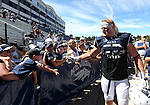 Nevada's Brock Hekking (53) greets fans as he walks off the field following an NCAA college football game against Southern Utah on Saturday, Aug. 30, 2014 in Reno, Nev. (AP Photo/Cathleen Allison)