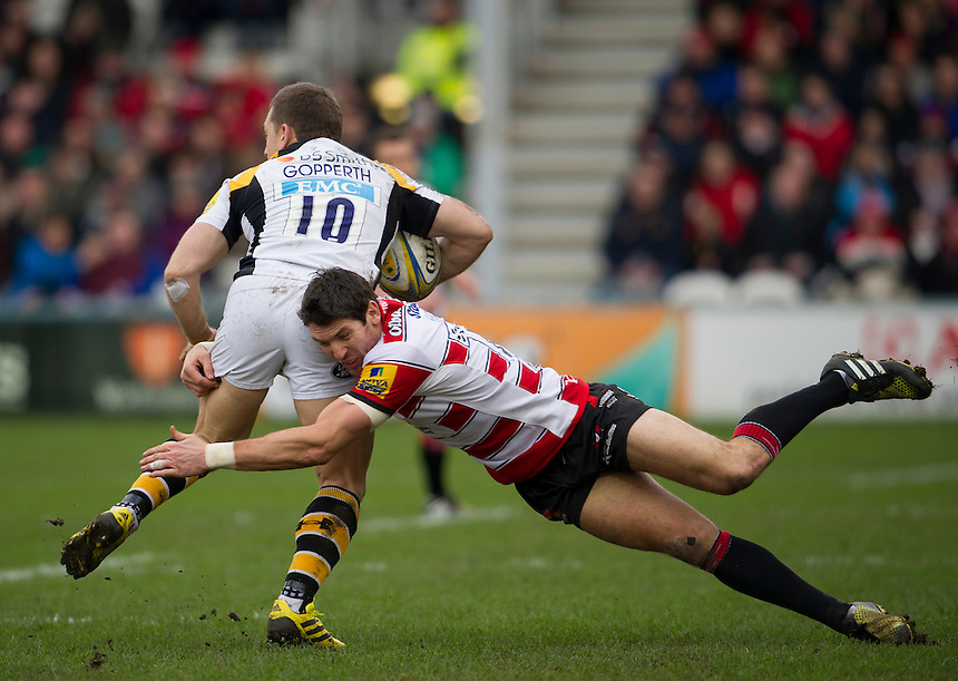 Wasps' Jimmy Gopperth is tackled by Gloucester Rugby's James Hook<br /> <br /> Photographer Ashley Western/CameraSport<br /> <br /> Rugby Union - Aviva Premiership Round 15 - Gloucester Rugby v Wasps - Saturday 5th March 2016 - Kingsholm Stadium - Gloucester<br /> <br /> &copy; CameraSport - 43 Linden Ave. Countesthorpe. Leicester. England. LE8 5PG - Tel: +44 (0) 116 277 4147 - admin@camerasport.com - www.camerasport.com