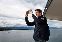 Swiss, Genève, September 14, 2015, Tennis,   Davis Cup, Swiss-Netherlands, Dutch team on a boat trip on lake Geneve, Team manager Guus van Berkel records the scene<br /> Photo: Tennisimages/Henk Koster