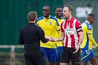 The match official calls for calm as Elliot Styles of Hornchurch and Jorge Djassi Sambu protest during AFC Hornchurch vs Haringey Borough, Bostik League Division 1 North Football at Hornchurch Stadium on 10th February 2018