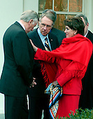 "Washington, D.C. - January 10, 2007 -- The Speaker of the United States House of Representatives Nancy Pelosi, (Democrat of California), right, straightens a pin on the lapel of United States Representative Steny H. Hoyer (Democrat of Maryland) House Majority Leader, as U.S. Senator Harry Reid (Democrat of Nevada), Senate Majority Leader, looks on at the White House in Washington, D.C. on Wednesday, January 10, 2007. Later, the Democratic Congressional Leadership made remarks where they complained that their meeting with the President was ""a notification, not a consultation""..Credit: Ron Sachs / CNP"