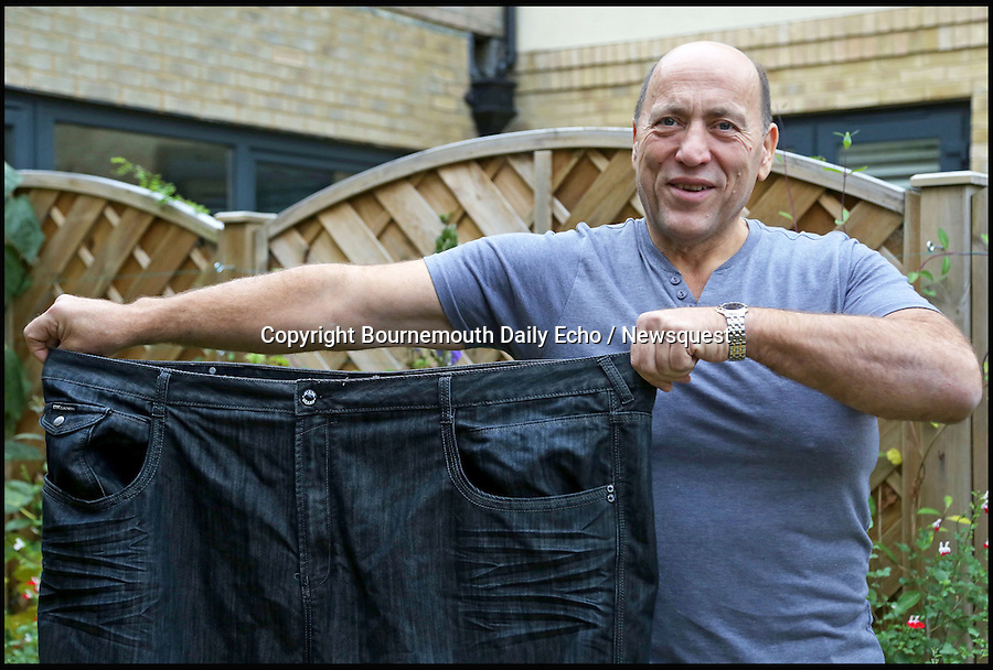 BNPS.co.uk (01202 558833)<br /> Pic: SamSheldon/BNPS<br /> <br /> Geoff Divall with his 60 inch waist trousers.<br /> <br /> A portly plumber who went on a diet after getting stuck under floor boards on a job has lost a massive 11 stone in 12 month.<br /> <br /> Despite being a vegetarian Geoff Divall, 52, tipped the scales at 28 stone and was as wide as he was tall after spending years gorging on cheese and chocolate.<br /> <br /> His obese size led to him having type 2 diabetes and suffering from heart problems. His XXXXXXL size also forced him to have to travel to America once a year to buy big clothes.