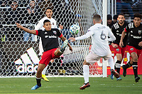 WASHINGTON, DC - MARCH 07: Edison Flores #10 of DC United boots the ball away from Wil Trapp #6 of Inter Miami during a game between Inter Miami CF and D.C. United at Audi Field on March 07, 2020 in Washington, DC.