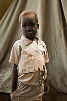 "Portait of child in Nyori refugee camp in Congo. The LRA has been attacking villages in Congo since late 2008 and kidnapping children as young as 5 years old. the boys serve as porters or soldiers in training and the girls  are given to LRA soldiers as ""wives."""