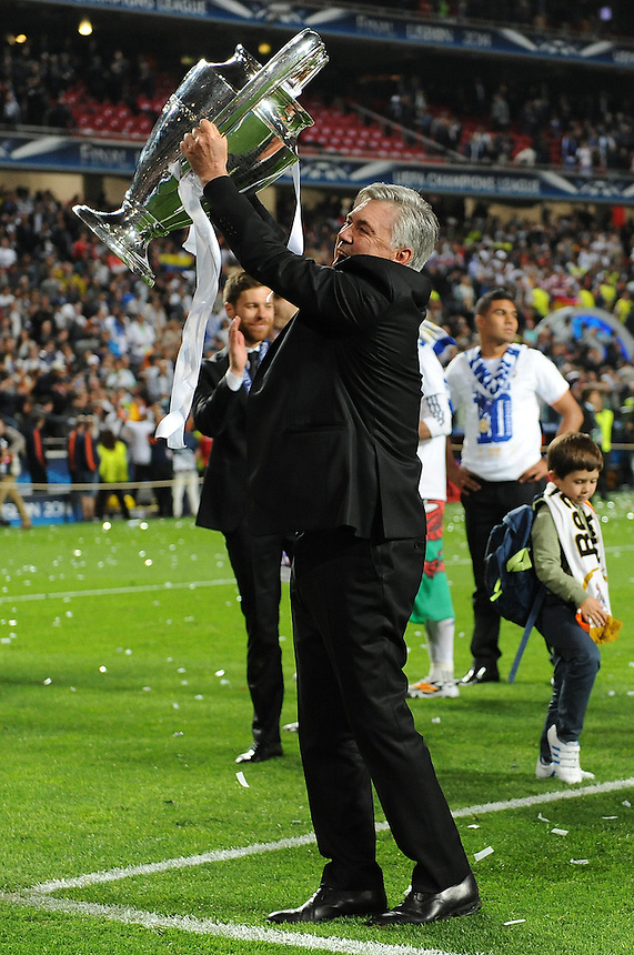 Real Madrid's Manager Carlo Ancelotti  lifts the UEFA Champions League Final trophy<br /> <br /> Photographer Ian Cook/CameraSport<br /> <br /> Football - UEFA Champions League Final 2014 - Real Madrid v Atletico Madrid - Saturday 24th May 2014 - Stadium of Light - Lisbon - Portugal<br /> <br /> &copy; CameraSport - 43 Linden Ave. Countesthorpe. Leicester. England. LE8 5PG - Tel: +44 (0) 116 277 4147 - admin@camerasport.com - www.camerasport.com