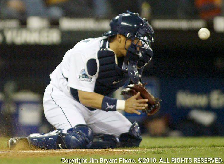 Seattle Mariners' catcher Kenji Johjima of Japan stops Ichiro Suzuki's throw from center field in the fifth inning of their major league baseball game adgainst the San Diego Padres Saturday May 19, 2007 in Seattle. Jim Bryant Photo. ©2010. ALL RIGHTS RESERVED.
